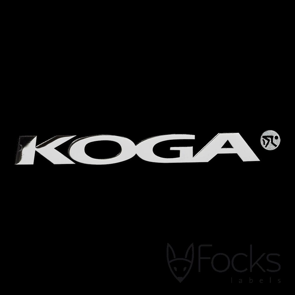 Logolabel Koga voor op fietsen, 3D metaal, zilverglanzend vernikkeld, voorzien van kleeflaag, met transparante overdrachtsfolie t.b.v. montage