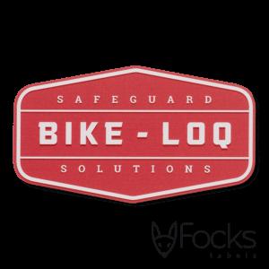 Merk label Bike Loq, voor fietsslot, geanodiseerd aluminium, achtergrond rood bedrukt, slijtvast in het aluminium, contour gefreesd, voorzien van 3M468 kleeflaag.